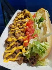 The Crazy Steak sandwich from the Crazy Daisy food truck is a cross between a Philly Cheesesteak and a hot roast beef po' boy.