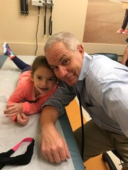 "The only child of Shara and Seth Moskowitz, Avery Moskowitz, 8, - here with her pediatric oncologist Dr. John M. Maris of CHOP - is a fighter. For the majority of her young life, Avery — who was diagnosed at age 3 with stage 4 neuroblastoma — has been fighting just to live. Now, she fights to help others live. Her latest effort — Avery's ""American Girl"" Doll Hair and Nail Salon — will be held from 9 a.m. to 3 p.m. May 12 at the Monroe Township Recreation Center on 120 Monmouth Road in Monroe."