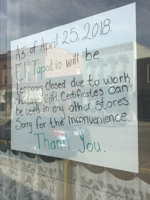 A sign in the window of El Tapatio in Dell Rapids says the location is closed temporarily due to workforce.