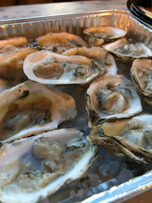 Oysters from Dakota Seafood at Friday happy hour at the Carpenter Bar.