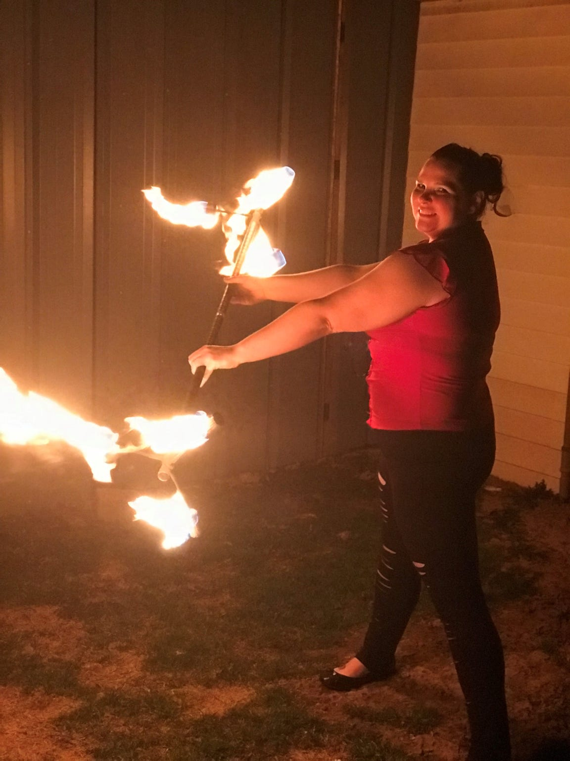 Valerie Ringwell practicing her fire tricks using a dragon staff. The 34-year-old picked up the hobby as a coping method after an assault two years ago.