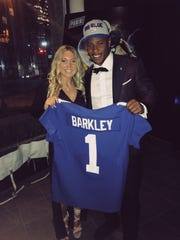 Saquon Barkley poses with hometown friend Kayla Cunningham after being drafted No. 2 overall by the New York Giants in Arlington, TX on Thursday, April 26, 2018.