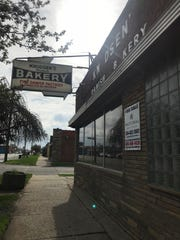 A National Realty Centers For Sale sign has been placed on Knudsen's Bakery.