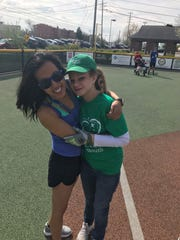 Coach and buddy coordinator Rachel Koelzer gets a hug