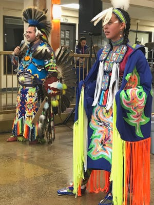 Anthony Quenelle, left, of the Roaring Creek Powwow Dancers from Montgomery Creek introduces his niece, Claudia Suarez, before she performs the Fancy Shawl dance Saturday at The Atrium for the Minds Matter Resource Fair.