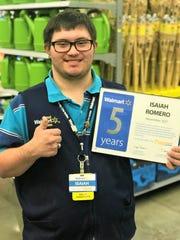 Isaiah Romero proudly displays his 5 year employee