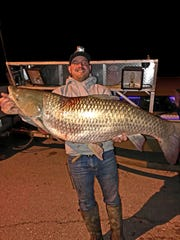 Bow fisherman Justin Sinclair shot this huge grass carp recently. It weighed 63 pounds, but its weight had dropped to 56 pounds by the time he got it to certified scales.