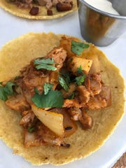 Al pastor tacos are served on homemade tortillas at
