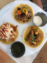 A trio of tacos at MezCali Taqueria - sweet potato,
