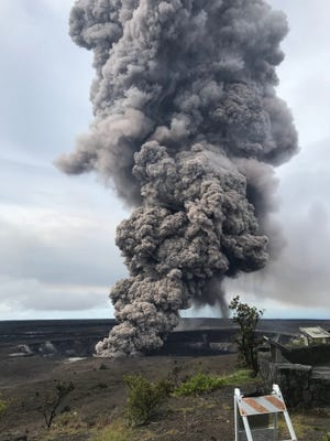 This image obtained May 10, 2018, released by the U.S. Geological Survey shows ash column as it rises from the Overlook crater at the summit of K'lauea Volcano on May 9, 2018.