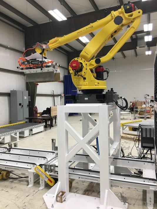636615621607114726-QComp-Technologies-Robot.JPG