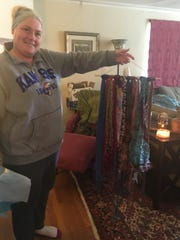 Reno mom and writer Emily Reese holds up a wall hanging