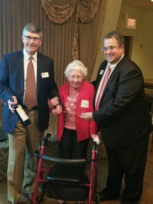 Marguerite Soffa is presented with the Wisconsin Alumni Association's Badger of the Year Award by Fond du Lac Chapter Vice President Steve Millin, left, and Chapter President Steve Leaman, right.