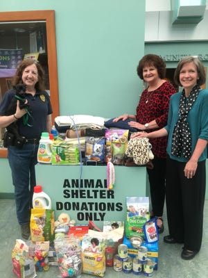(Left to right) Katie Nordhaus, animal control officer for Second Chance for Animals, with Gidget the chihuahua; Nancy Rainer, Second Chance for Animals volunteer and Franklin Township Public Library staff member; and Joan Serpico, Outreach and Reference Librarian for Franklin Township Public Library.