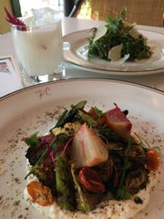 Roasted seasonal vegetables in the forefront, the kale and brussel sprouts salad in the background and Cabana Colada.