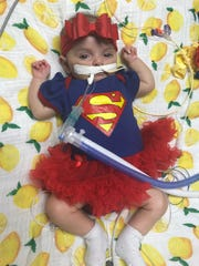 "Five-month-old Lucia Torres is ""super baby"" after her heart transplant at Joe DiMaggio Children's Hospital in Hollywood, Fla."