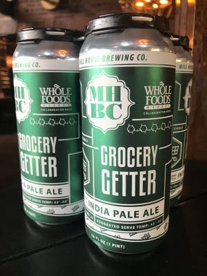 Cans of Grocery Getter, a New England IPA from Mill House Brewing Co. made in collaboration with Whole Foods Market.