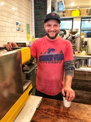 John Minotti, co-owner of Sunshine Coffee Roasters in Larchmont serves up coffee with a smile. May 17, 2018