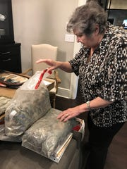 Sherry Sanders shows the belongings of her uncle, Marine 2nd Lt. Harvel Lee Moore. Moore was killed during World War II, and his remains will be brought back to Louisiana for burial this week.