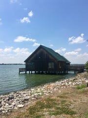 Overnight visitors can stay in cabins on the water at Poverty Point Reservoir State Park in Delhi.
