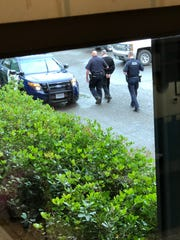 This image shows Redding police walking a man believed to be IASCO Flight Training general manager Jonathan McConkey in May 2018. The photo was provided to the Record Searchlight by flight school student Zhang Xun Yi.