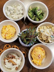 Planters Cafe and Coffee Bar is well known for a selection of freshly made deli salads. Pictured clockwise from bottom left: Olive nut spread, pimento cheese, Greek chicken salad, broccoli salad, pasta salad, and more pimento cheese.