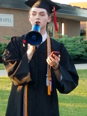 """Christian Bales, the valedictorian of Holy Cross High School, delivers his graduation speech outside with a megaphone after the ceremony took place.The Diocese of Covington last weekend banned the graduation speeches from the Bales and student council president of the school, with officials saying they contained """"elements that were political and inconsistent with the teaching of the Catholic Church."""""""