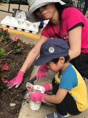 Akira Umetani lends a helping hand to his mom, Keiko Umetani.