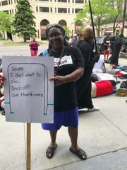 Home-care provider Camille Allen tells Bill Schuette to back off her healthcare.