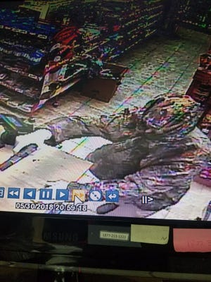 Randolph County deputies released this photo, from a surveillance camera, that shows a bandit who held up a Losantville convenience store late Wednesday.