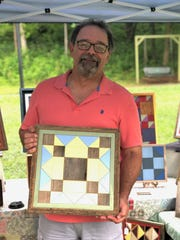 Don Grogan with one of his new Scrap Wood Quilts at