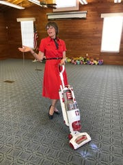 The fun never ends with Garden Club of Fort Pierce. New member Valerie Niewieroski in retro costume, pitches in to clean up after a beautiful day!