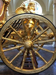 A detail from the gold state coach in the Royal Mews in London. The site houses stables, a carriage house and a garage for the royal family at Buckingham Palace.