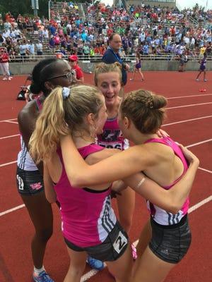 West Lafayette's 3,200 relay team celebrates winning a state championship Saturday at Indiana University.