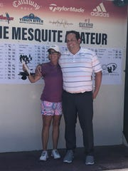 Gigi Higgins poses with her trophy for lowest gross