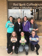 """Two Rivers High School FACT students recently participated in a """"One For Me, One For You"""" FACTivism in downtown Two Rivers."""