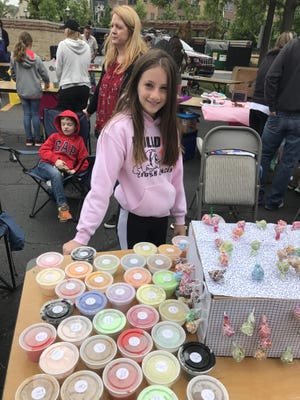 Hannah Nelson, 12, a sixth-grader at Maltby, sells her own brand of slime at the Children's Entrepreneurial Fair in Brighton on Saturday, June 2.
