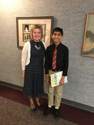 Seventh-grader Tanmay Kudapur with teacher Elaine Vermiglio.