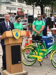 Mayor Tom Roach introduces bike sharing pilot program