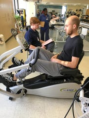 Tyler Wheeler said physical therapist Alex Touchstone, left, was among the Methodist Rehabilitation Center staff in Jackson who kept him motivated while he worked to recover from four gunshot wounds received in Louisiana.