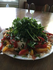 A summer Burrata Salad is offered by Silver Spoon in