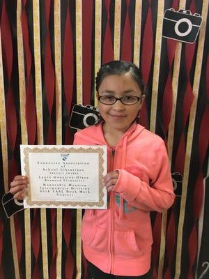 Laura Gonzalez-Olaya shows off her certificate.