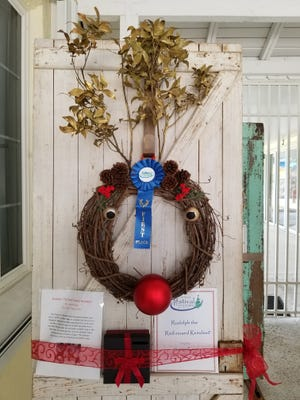 This wreath designed and donated by Girl Scout Summer Ernst earned first place for most creative wreath at the 2017 Festival of Trees.