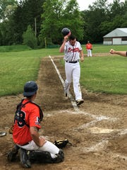 Big Flats Braves' Tyler Melko finishes off his homerun