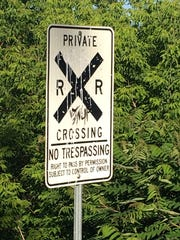 An often-unheeded sign near the Blue Bridge, a double-truss railroad bridge over the Winooski River.