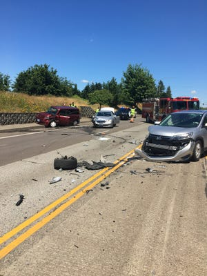 A three-vehicle accident blocked Kuebler Boulevard SE Monday afternoon.