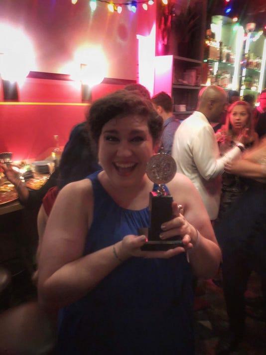 Ashlee Latimer with Tony Award
