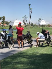 From push carts to umbrellas to sitting when they can,