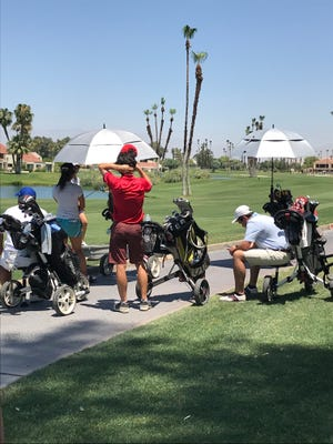 From push carts to umbrellas to sitting when they can, AJGA golfers take various routes to combat the heat in the ClubCorp Mission Hills Desert Junior event.
