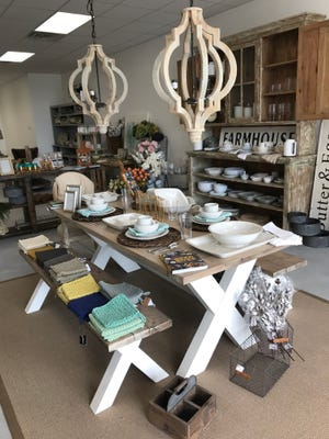 Not just the Juliska dinnerware items on the farmhouse table are offered at Frankie's. The table, made by store owner Bekah Ellis Turner's father and brother, can be bought or the duo can be commissioned to make one.